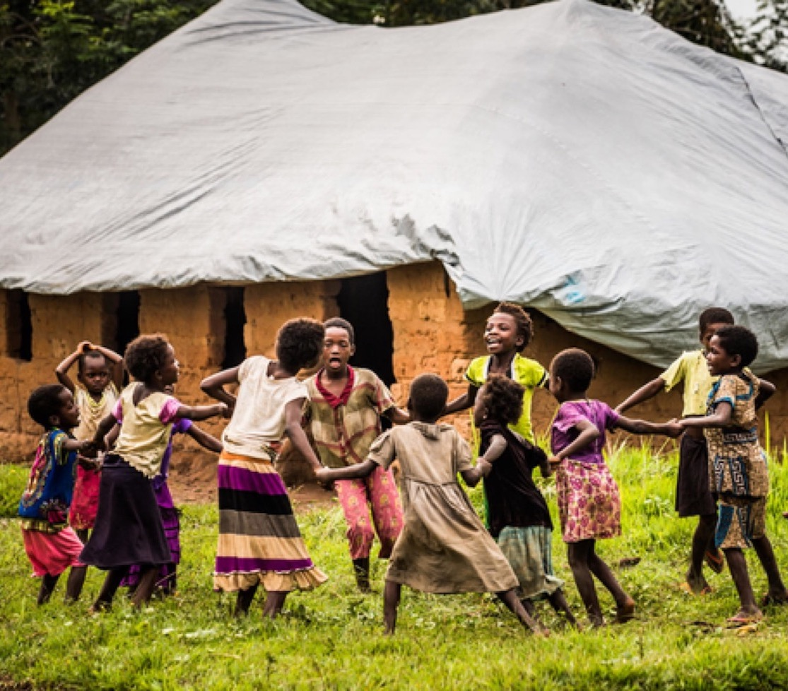 Children play outside of a temporary school set up by UNICEF during a mid-day break, near Mbuji Mayi, Kasaï region, Democratic Republic of the Congo, Saturday 27 January 2018.  The humanitarian situation in the Democratic Republic of the Congo has deteriorated dramatically over the past year. A surge in violent conflict in the Kasaï and Eastern regions has forced many people from their homes, including in the Kasaï region. UNICEF has scaled up integrated health, water, sanitation and hygiene (WASH), nutrition, education, protection in the country, with a focus on the Kasaï and Eastern regions.